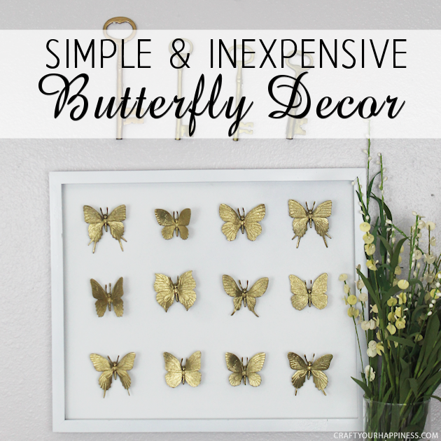 Hard to believe but this beautifully DIY framed butterfly decor piece was made with an old black frame that was missing the glass and some toy butterflies!