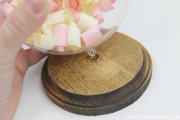 """If you're looking for something unique and special for a Valentine's Day gift ideas for him or her this one is pretty exceptional. It's made with a 5"""" plastic take apart globe and a wood base. Then you fill it with rolled up strips of paper that are things you want to """"manifest"""". Use it at any time or age."""