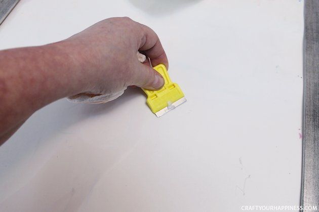 It's super easy to make any size DIY dry erase board using a roll of adhesive backed dry erase paper. We made a kitchen board and added some extras including making our own eraser!