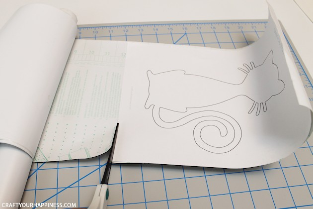 Making stencils from contact paper is cheap, lets you cut your own designs, you can make really big stencils and best of all, the stencil stays in place!