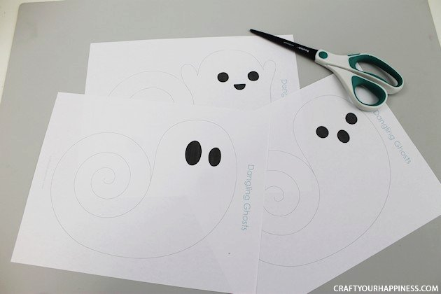 Need quick Halloween decorations? Grab our printables, some scissors or X-acto knife and before you know it you have have a room full of dangling ghosts!