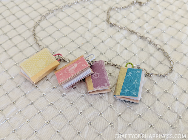 You won't believe how quick and easy it is to make miniature books with a large craft stick, some paper, glue & our free printable full of book covers!