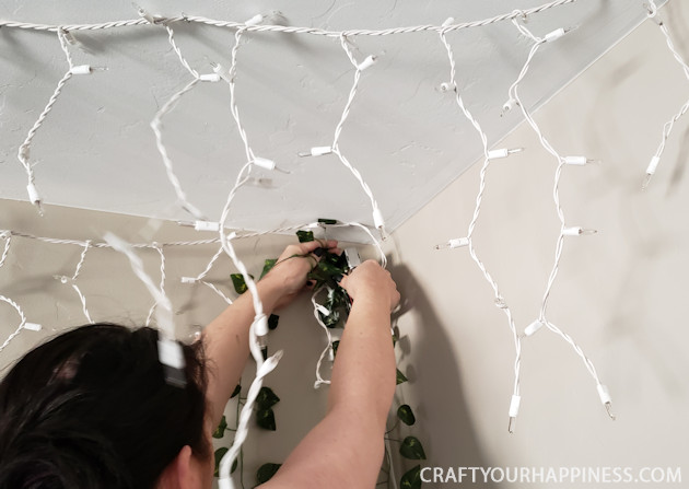 Looking for unusual inexpensive ceiling decorating ideas? Learn how to make our woodland twinkle light ceiling decor project. It's breathtaking!