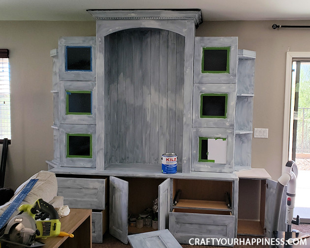 See our hutch makeover! We took an old huge black hutch and turned it into a modern beautiful hutch using paint, new hardware and a little ingenuity!